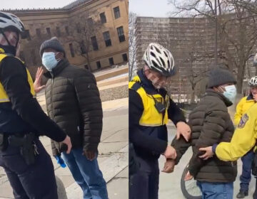 A swarm of Philadelphia police officers arrest a man they accused of soliciting money in return for photos outside the Philadelphia Museum of Art. (Claire Wolters)