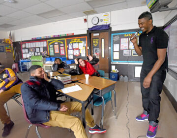 In 2015, Camden High teacher Alex Jones in the classroom on the day he tells his students he is leaving teaching to become an administrator.  (Photo by April Saul for WHYY)