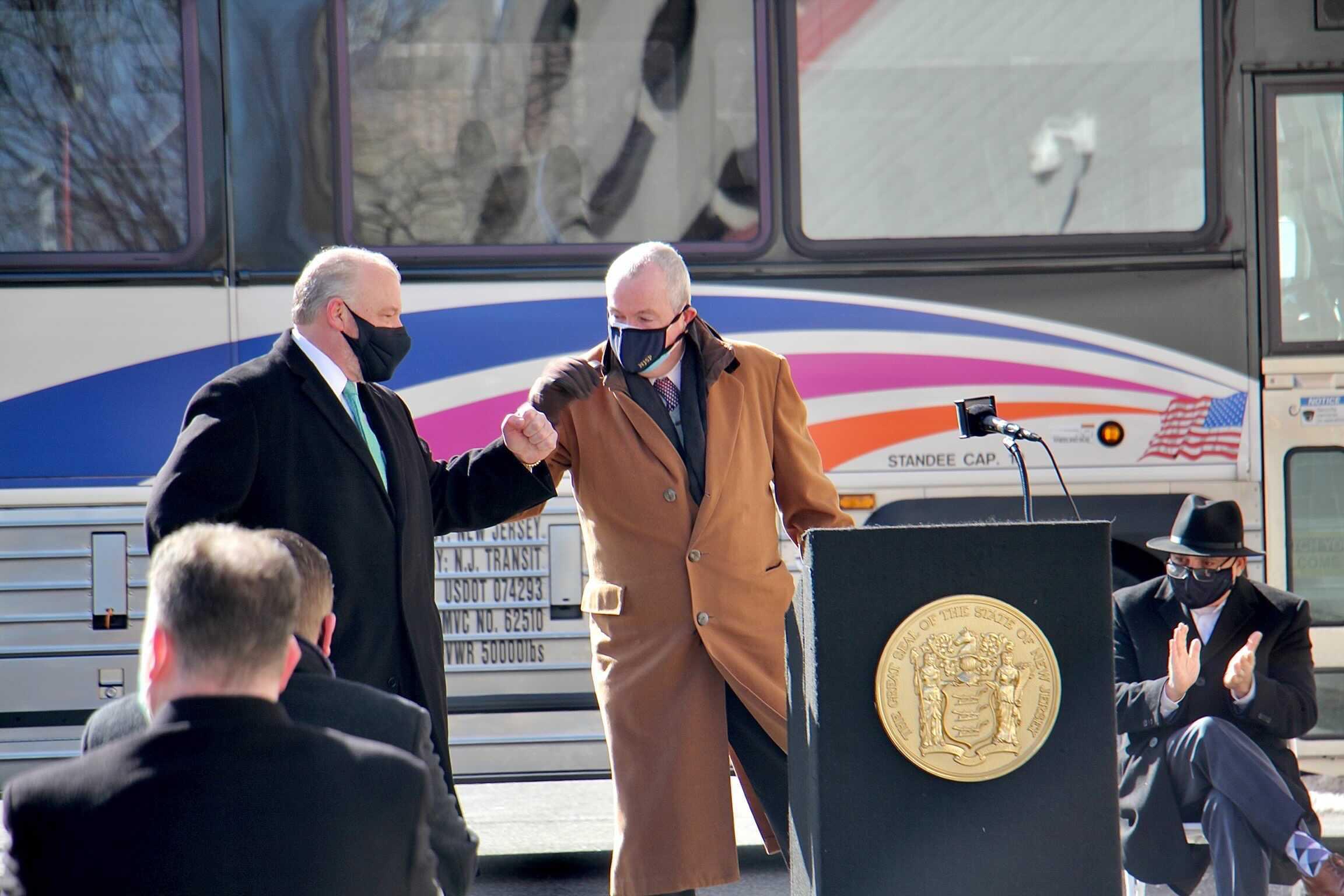 New Jersey Gov. Phil Murphy elbow bumps Senate President Steve Sweeney