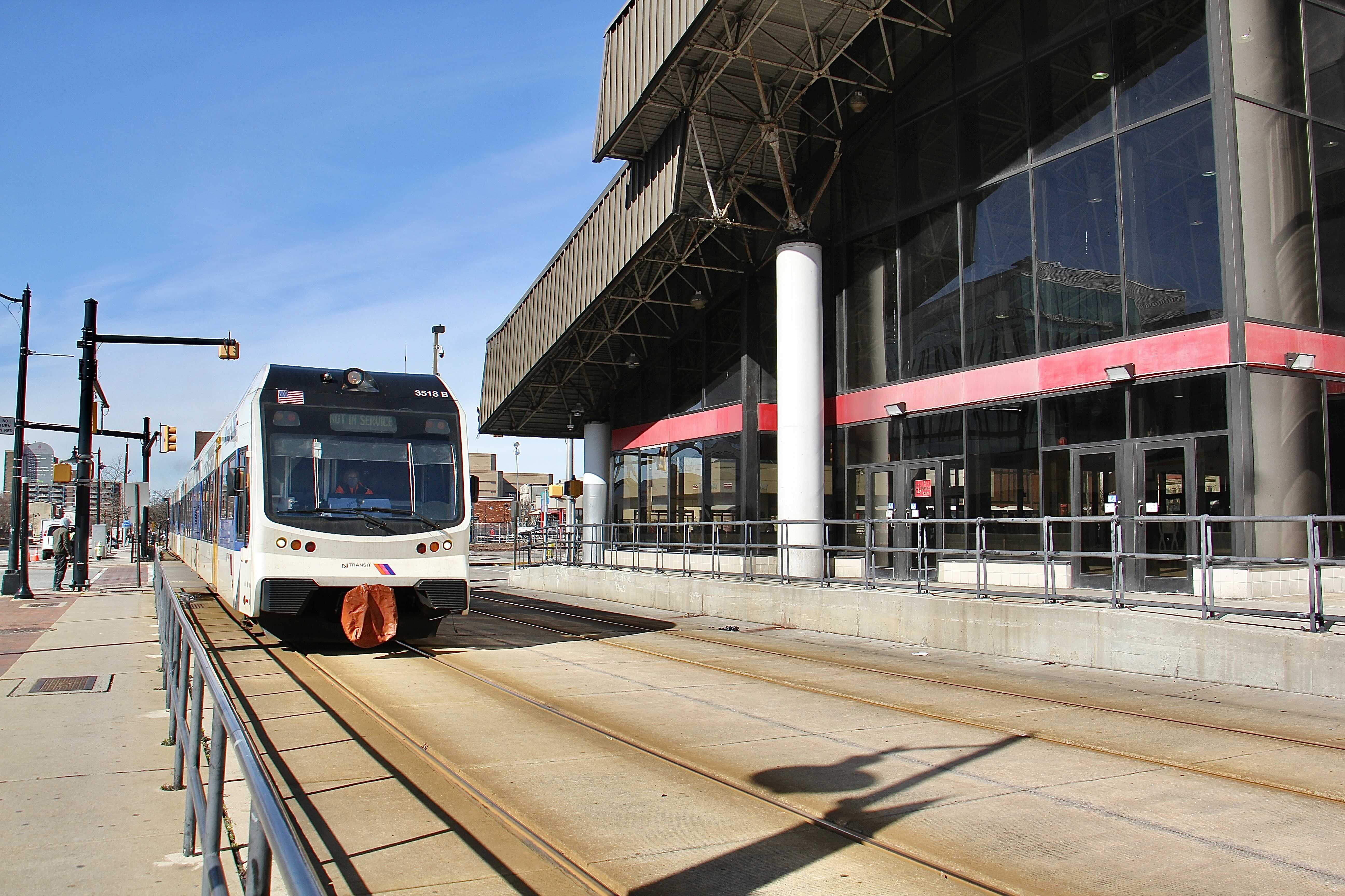 A Riverline train passes the Walter Rand Transportation Center in Camden