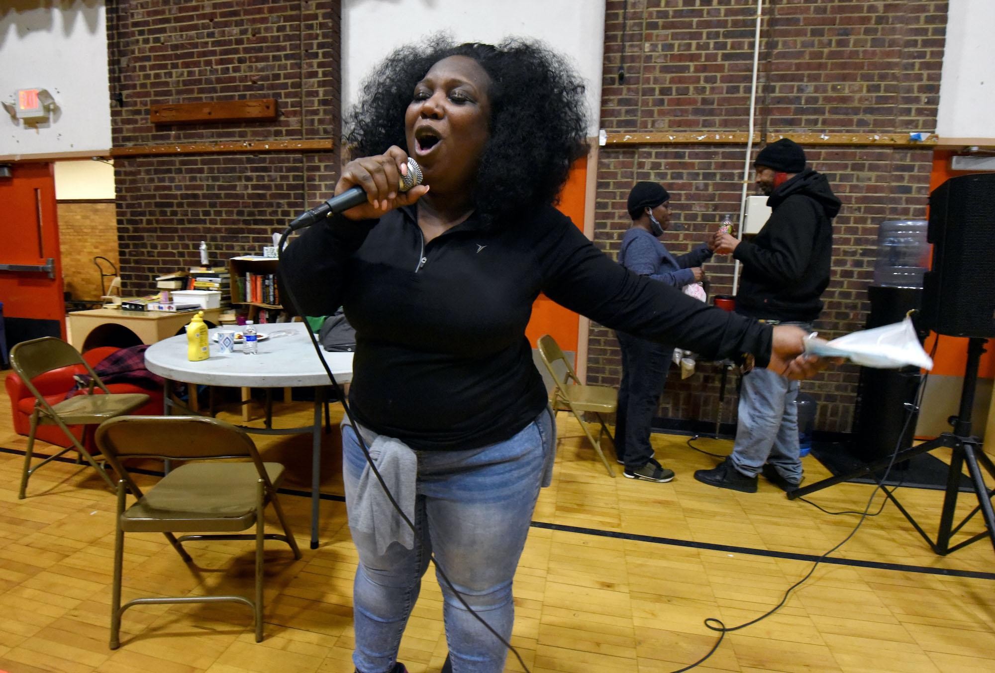 Tawanda Jones breaks into song to entertain her patrons