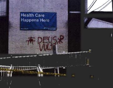 Samuel Gulick spray-painted the Newark medical facility before throwing a Molotov cocktail through the window in January 2020. (U.S. Attorney's Office)