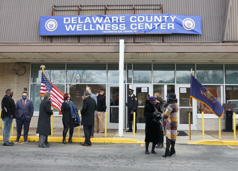 People stand outside the Delaware County Wellness Center