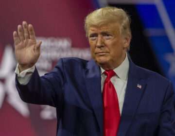 Then-President Donald Trump waves at the crowd during the 2020 Conservative Political Action Conference. This year, Trump is out of office but is still headlining the event. (Tasos Katopodis/Getty Images)