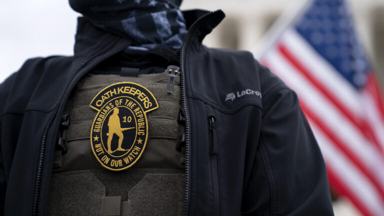A demonstrator wears an Oath Keepers anti-government organization badge on a tactical vest during a protest outside the Supreme Court in Washington, D.C., on Jan. 5, 2021. (Stefani Reynolds/Bloomberg via Getty Images)