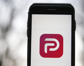 Parler, a social media network embraced by right-wing users, announced its relaunch, a month after it was dropped by app stores and its Web host in the wake of the Capitol riot. (Hollie Adams/Getty Images)