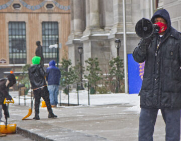 Jamal Johnson protests in the snow at City Hall