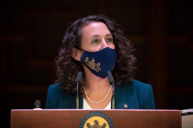 Pennsylvania Secretary Kathy Boockvar, wearing a face mask, addresses the media from behind a podium