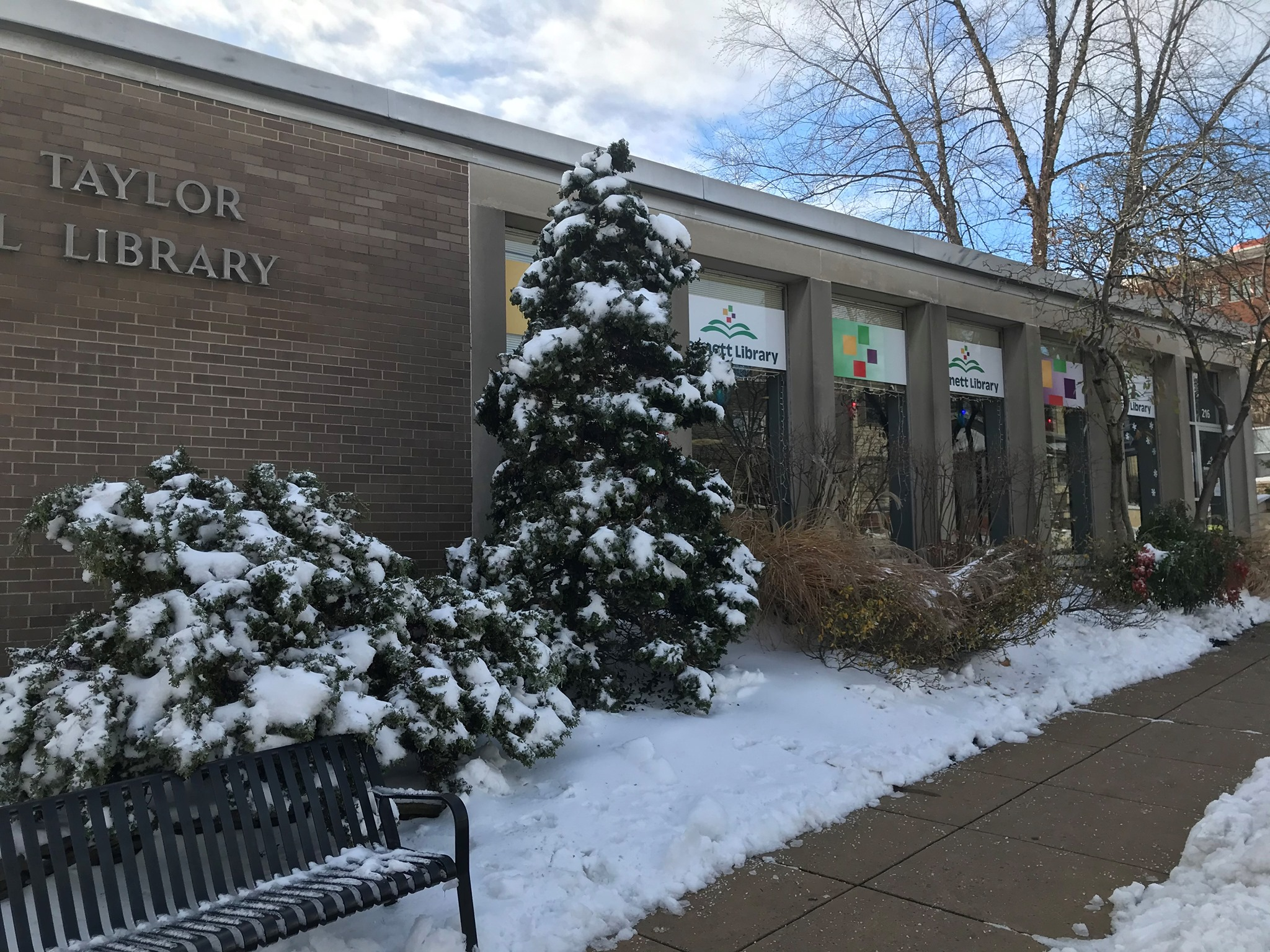 The exterior of Kennett Library. surrounded by snow