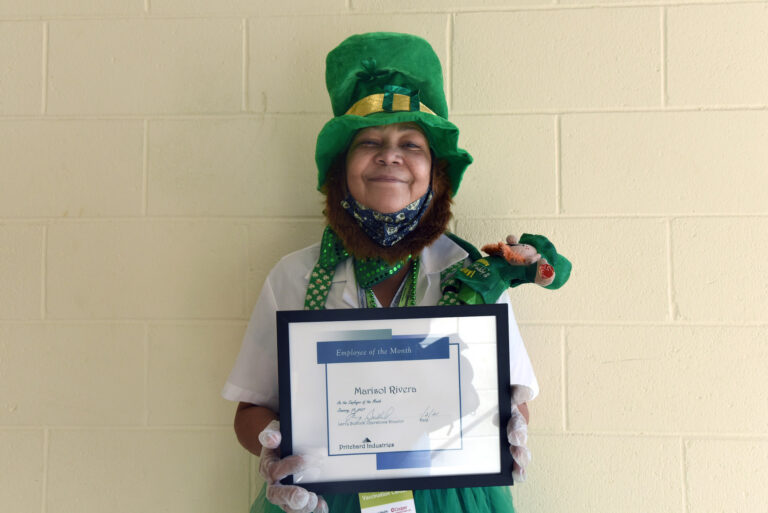 On January 27 at the COVID-19 vaccination center at Camden County College in Blackwood, NJ, Marisol Rivera shows off the Prichard Industries Employee of the Month certificate she's just been awarded. (April Saul for WHYY)