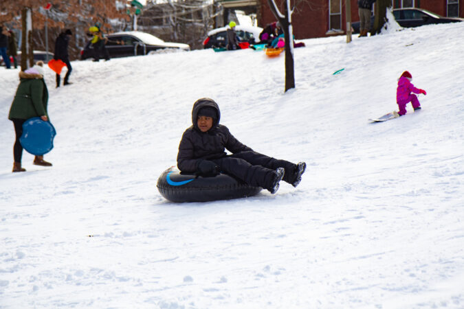 A person sleds at Clark Park in West Philly
