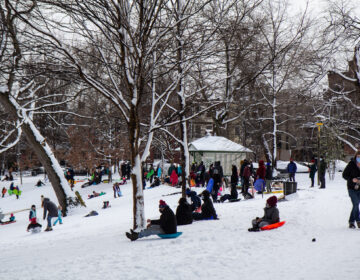 Residents play in the snow at Clark Park