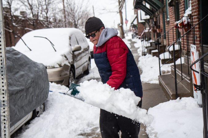 A man shovels snow in Philadelphia