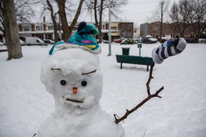 A snowman greets its neighbors at Powers Park in Port Richmond.