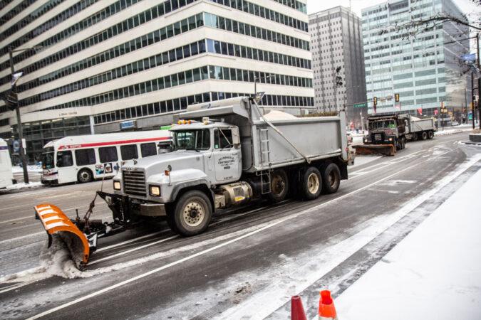 Snow plows circle City Hall
