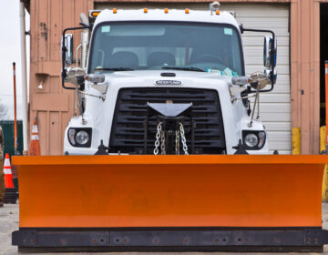 The Streets Department converts sanitation trucks into snow plows when needed. (Kimberly Paynter/WHYY)