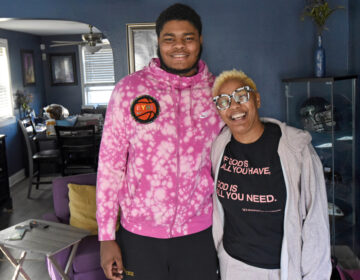 Ta'Quan Woodley poses for a photo with Tracey Hall, who invited him to live in her Camden home in February of 2020. She said he has been