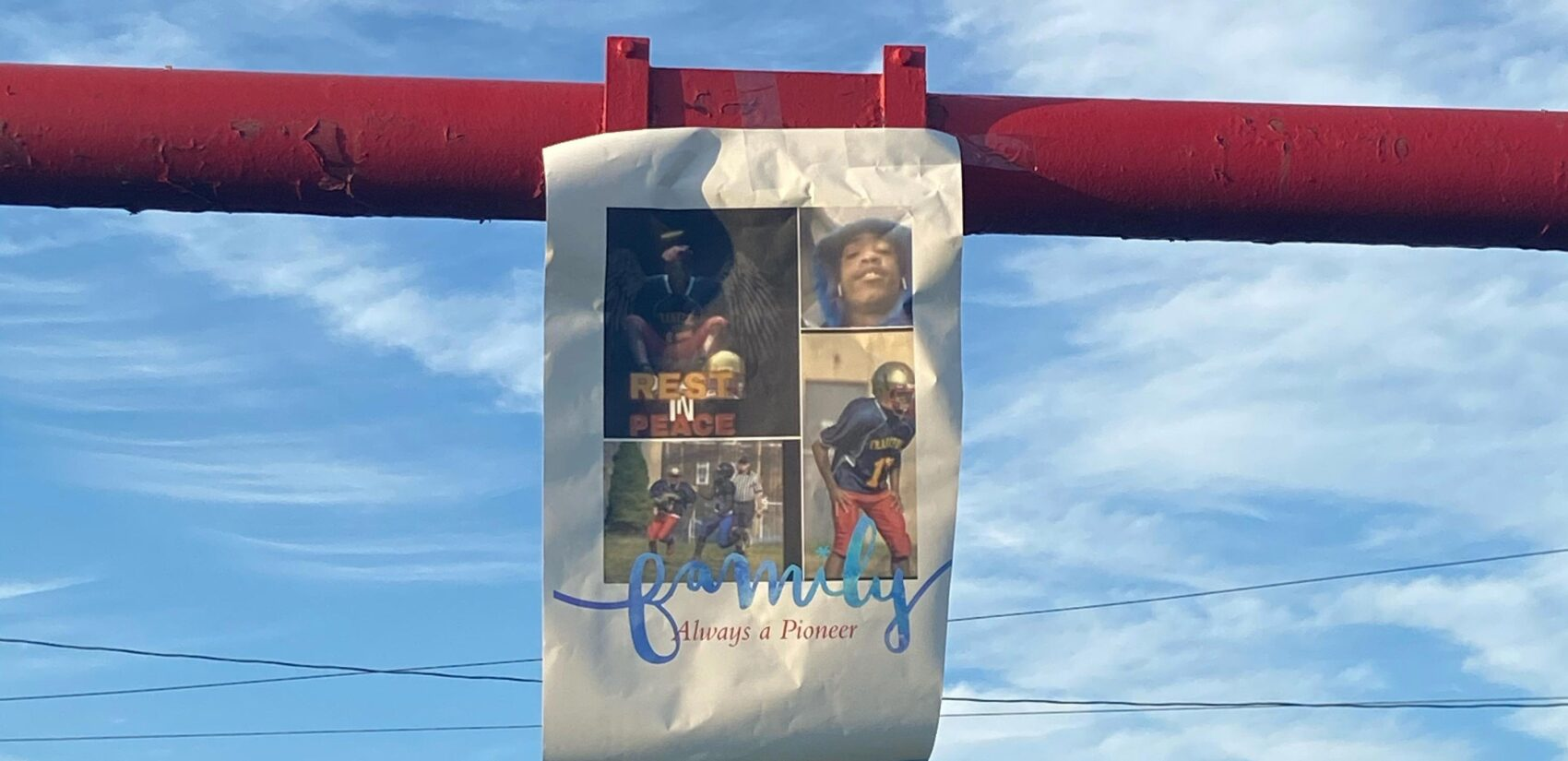 A flyer hangs on the goal post of the Frankford High School football field during Angelo Walker's memorial. (Courtesy of Isabella DiBileo)