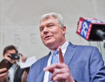 John Dougherty exits federal court