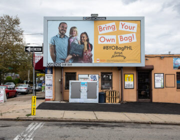 A Mural Arts Philadelphia billboard urging people to use reusable bags. (Steve Weinik/Mural Arts Philadelphia)