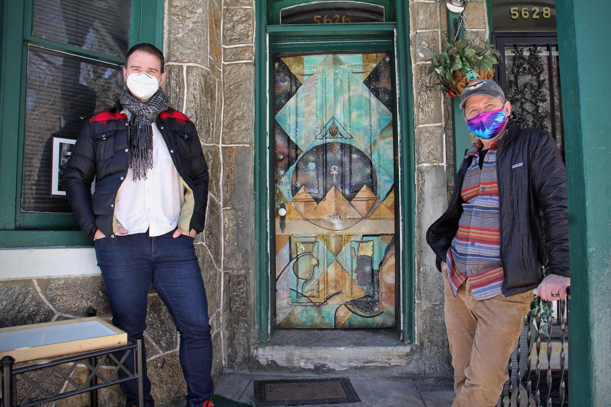 Mark Christman (left) and Frank Reiss stand outside the Sun Ra House