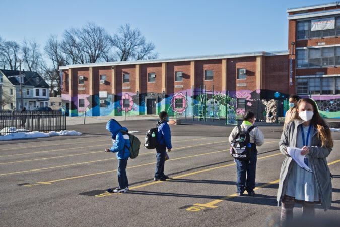 Students wait outside Wister Elementary School