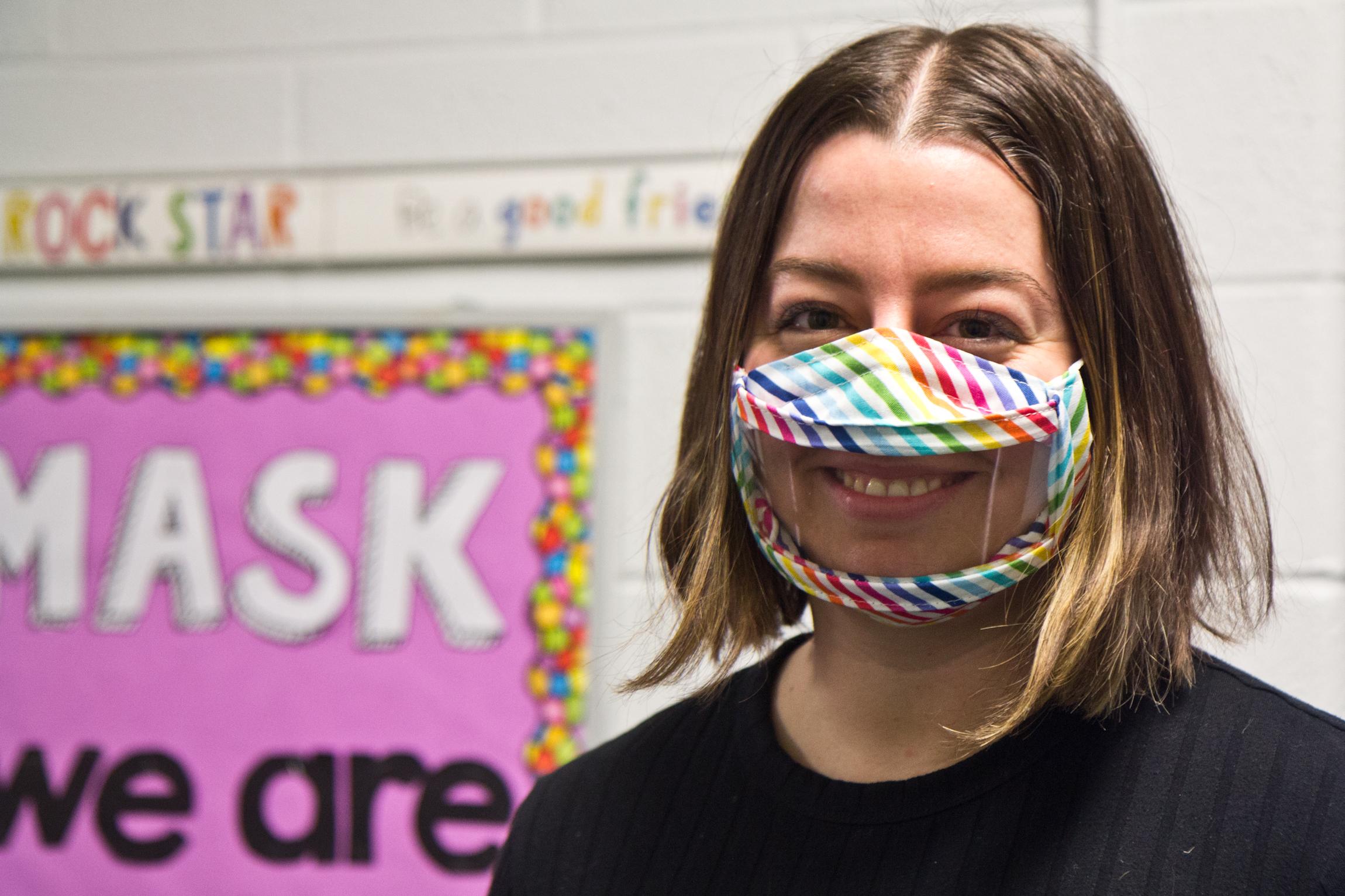 Kindergarten teacher Katie Trott wears a clear face mask inside the classroom