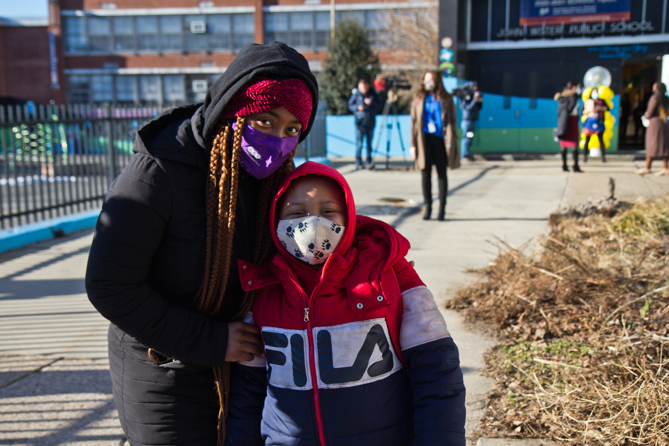 Deneen Kennedy stands with her son, Amari, outside