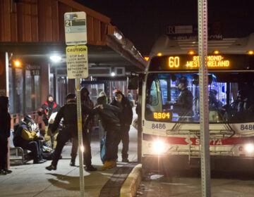 Transit police forcibly remover a violent passenger from a SEPTA bus in Upper Darby, Pa., around 1 a.m. on March 4, 2021. (Kimberly Paynter/WHYY)