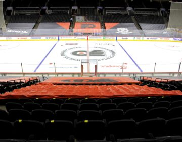 No one will be allowed to sit in the first ten rows around the ice in order to protect players, who have traded their plexiglass enclosures for netting to improve air circulation. (Emma Lee/WHYY)