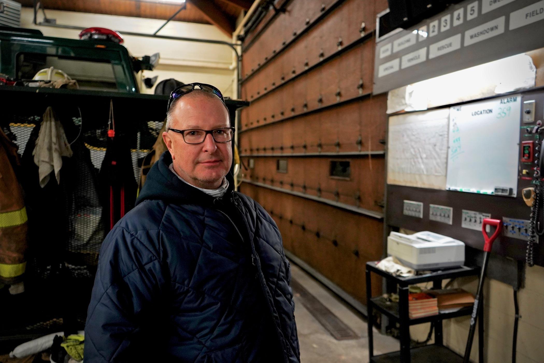 Thomas Prociuk stands inside a fire station