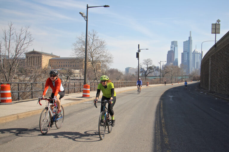 Cyclists and joggers use Martin Luther King Drive on March 11, 2021, which has been closed to traffic since the start of the pandemic. (Emma Lee/WHYY)