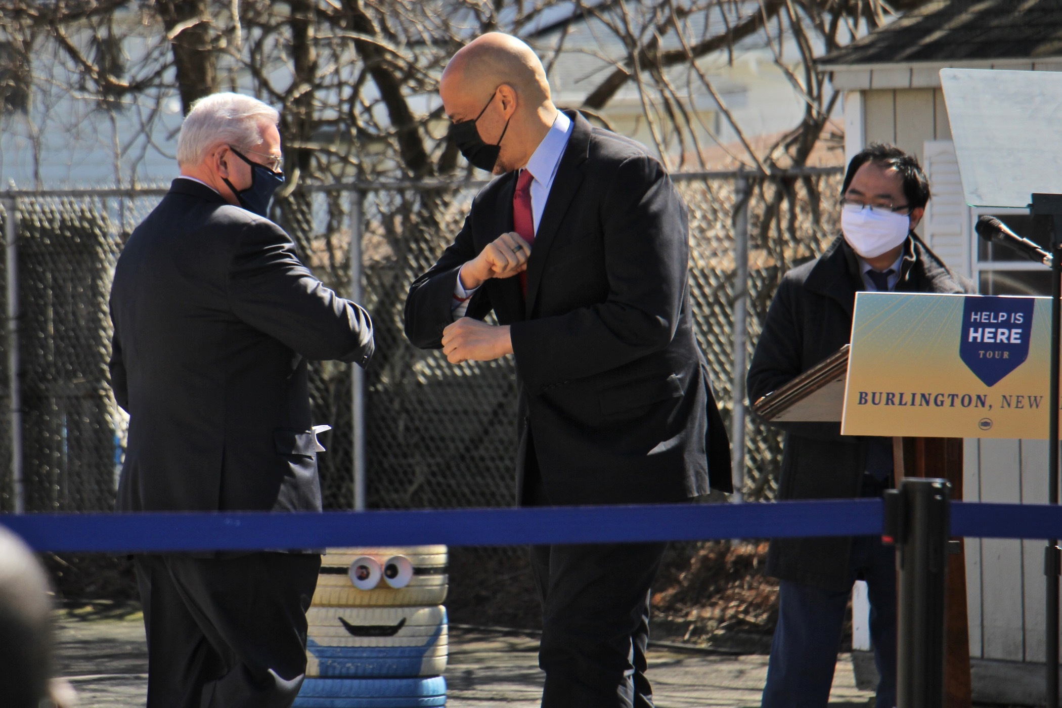 New Jersey U.S. Sens. Robert Menendez (left) and Cory Booker bump elbows while U.S. Rep. Andy Kim looks on