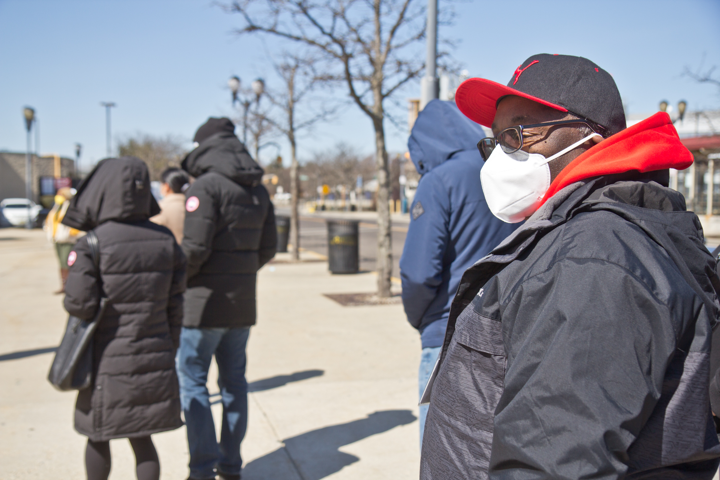 N.J. Transit worker Antonio Harriot waits in line to get the COVID-19 vaccine
