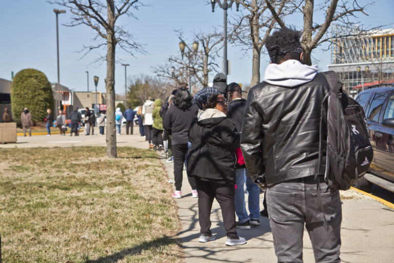 People line up for the COVID-19 vaccine outside the BB&T Pavilion in Camden