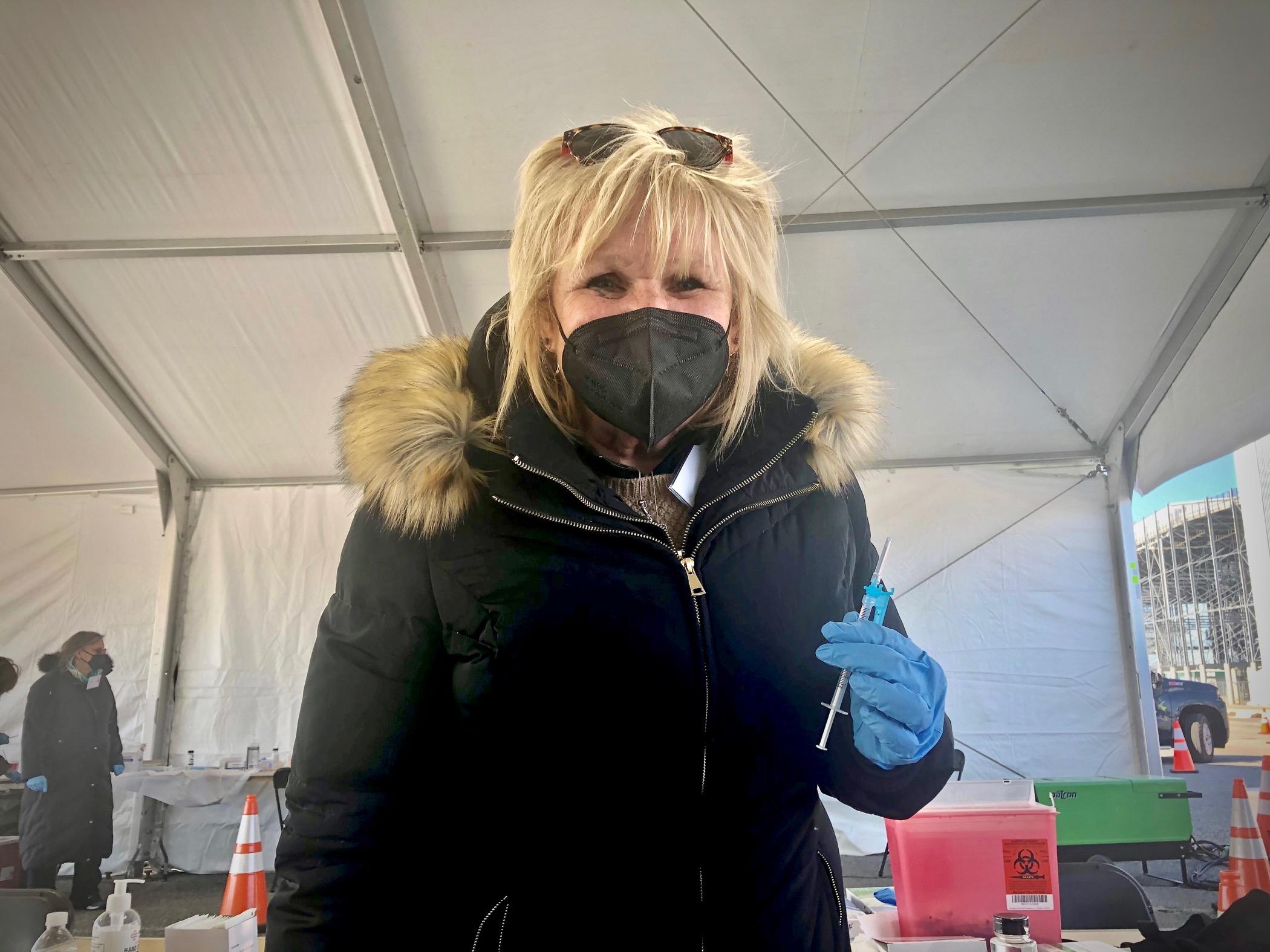 Nurse Debbie Petro wearing a face mask and winter coat
