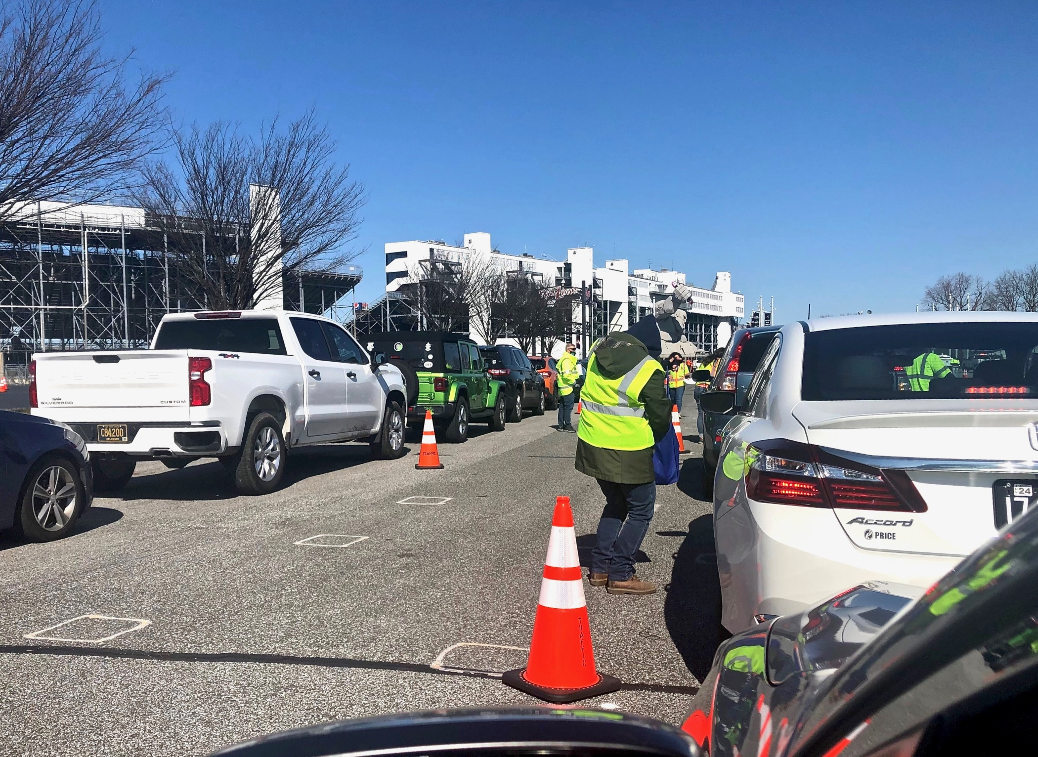 Drivers wait in line to receive COVID-19 vaccinations