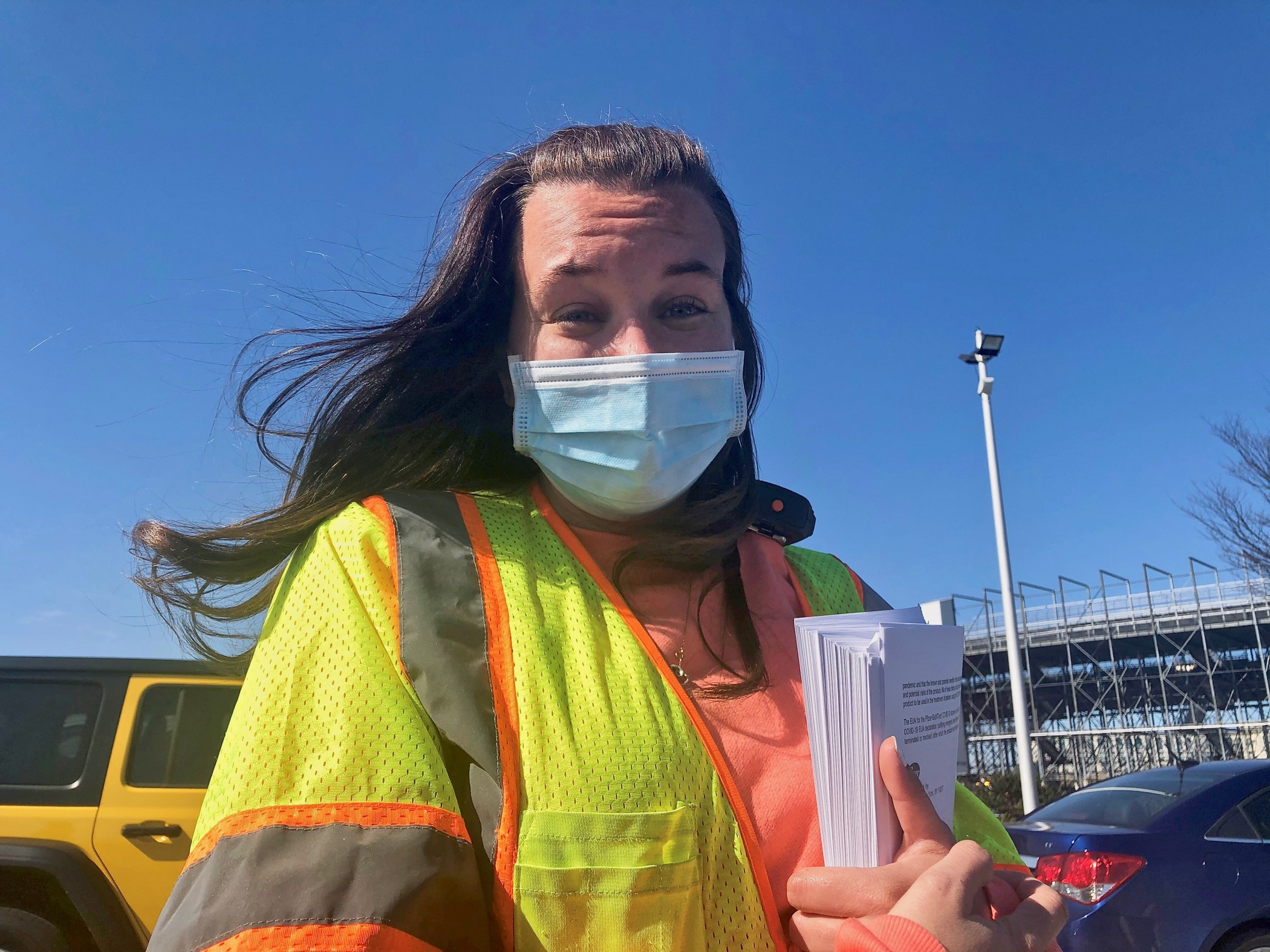DelDOT's Lara Brown wears a reflective vest and face mask