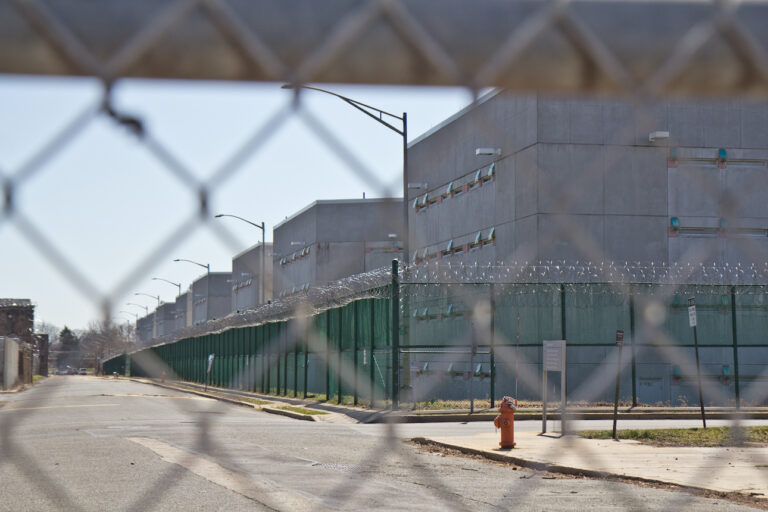 The exterior of Curran-Fromhold Correctional Facility as seen through a fence