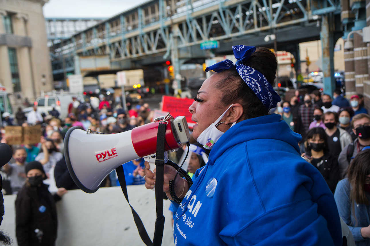 "Gloria ""Smoochie"" Cartagena speaks frmo a megaphone at a protest over Somerset Station's closure"