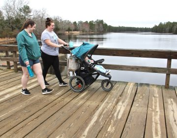 Maegan Nelson (right) and her cousin, Sarah Nargi, stroll along Batsto Lake in Wharton State Forrest with Nargi's daughter, Paisley.