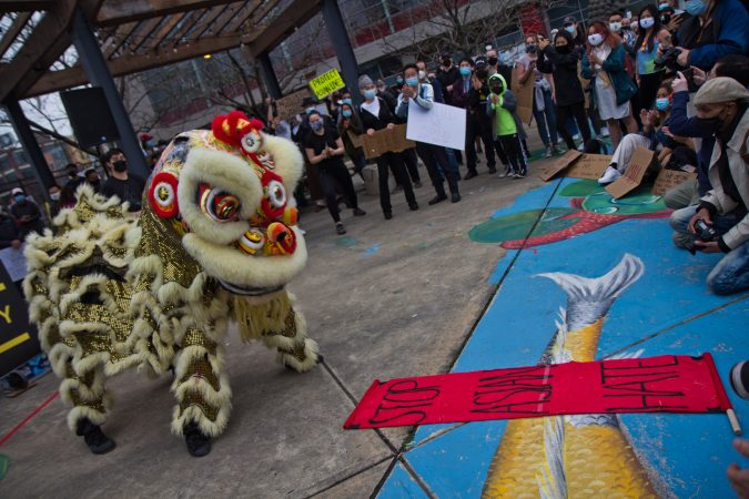 The Lion Dancers perform at a solidarity rally in protest of anti-Asian violence at 10th and Vine streets in Philadelphia on March 25, 2021. (Kimberly Paynter/WHYY)