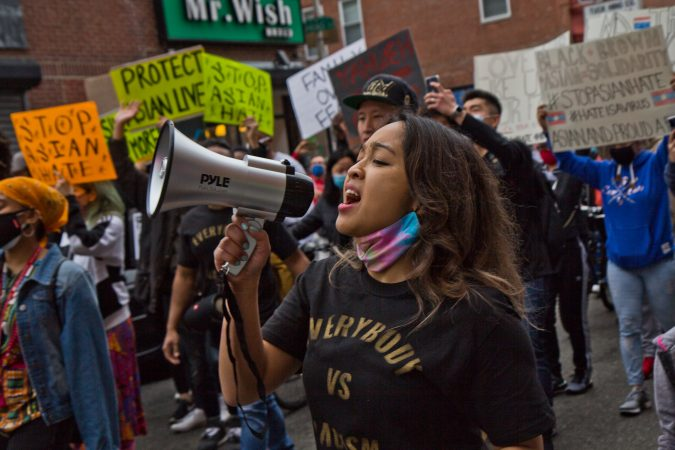 Raquel Villanueva helped to organize and lead a solidarity rally and march at 10th and Vine Streets in Philadelphia on March 25, 2021. (Kimberly Paynter/WHYY)