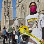 Zahirah Ahmad, a North Philly resident and member of the Not On My Watch movement, joined activists at a rally and march at City Hall in Philadelphia on March 26, 2021, to demand the city put more resources to preventing gun violence. (Kimberly Paynter/WHYY)