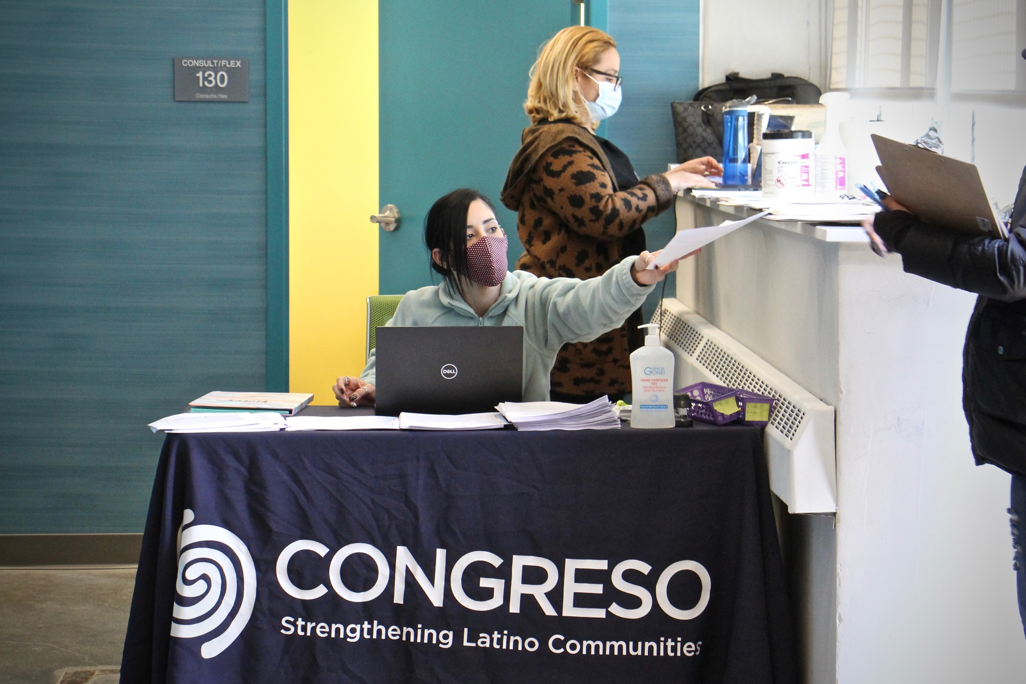 Medical assistants Yeishaliz Cruz (seated) and Luz Vasquez welcome patients to Congreso's COVID-19 vaccination clinic