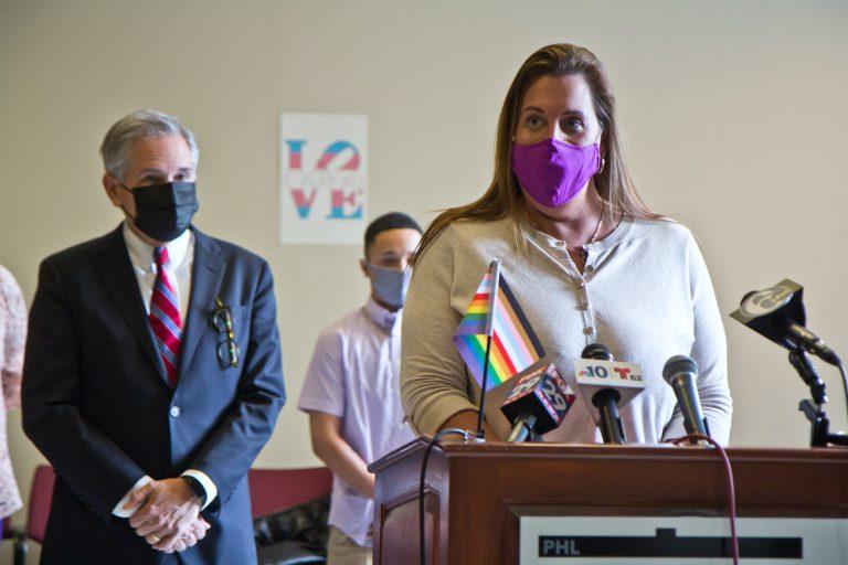 Deja Lynn Alvarez speaks at a podium