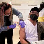 Thomas W. Munson receives his second dose of COVID-19 vaccine from registered nurse Elizabeth Lash