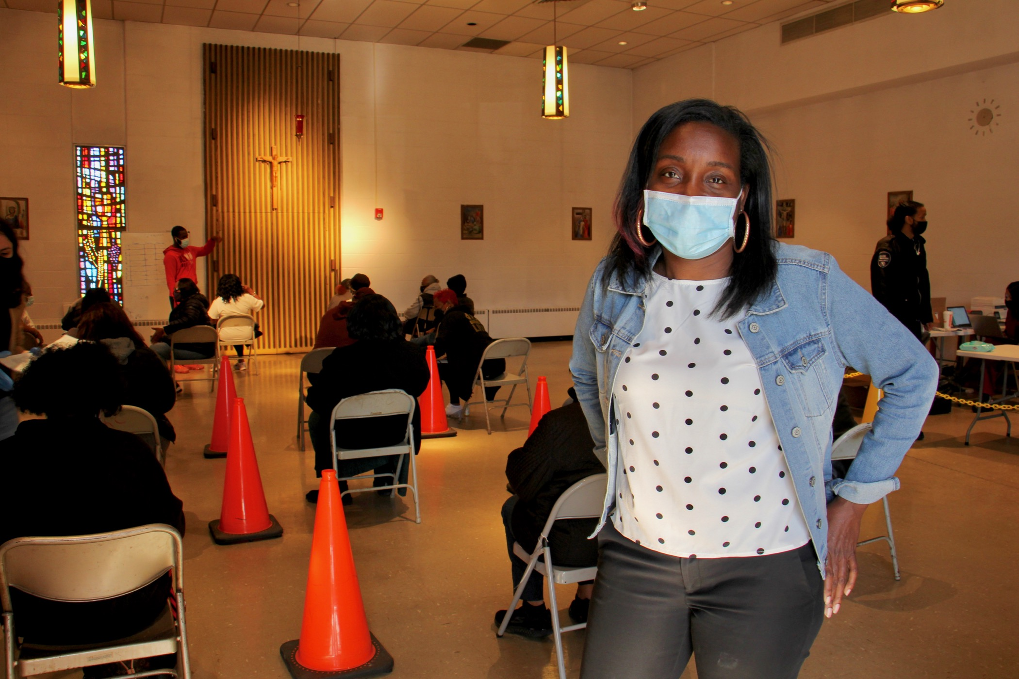 Kirsten Britt wears a face mask at a COVID-19 vaccine clinic
