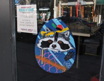 A decorated Easter Egg hanging in a window on South Street in Philadelphia