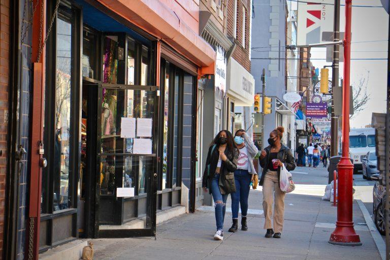 Shoppers walk on South Street